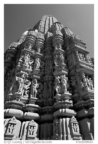 Sculptures and sikhara of Devi Jagadamba temple from below. Khajuraho, Madhya Pradesh, India (black and white)