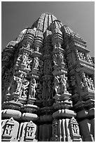 Sculptures and sikhara of Devi Jagadamba temple from below. Khajuraho, Madhya Pradesh, India ( black and white)