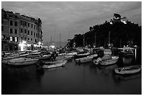 Harbor and San Giorgio castle at dusk, Portofino. Liguria, Italy (black and white)
