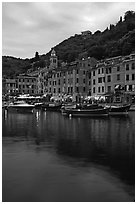 Yachts and fishing boats in Harbor at dusk, Portofino. Liguria, Italy ( black and white)