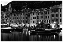 Pastes-colored houses around harbor at dusk, Portofino. Liguria, Italy (black and white)
