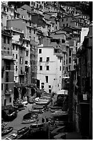 Plazza with parked boats built along steep ravine, Riomaggiore. Cinque Terre, Liguria, Italy ( black and white)