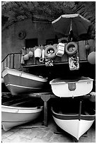 Tiny fishing boats stacked in the main square, Riomaggiore. Cinque Terre, Liguria, Italy (black and white)