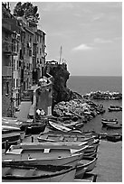 Fishing boats, harbor, and Mediterranean Sea, Riomaggiore. Cinque Terre, Liguria, Italy ( black and white)