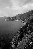Coast along the Via dell'Amore (Lover's Lane), looking north towards Corniglia. Cinque Terre, Liguria, Italy (black and white)