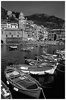 Colorful samll fishing boats in the harbor and main plaza, Vernazza. Cinque Terre, Liguria, Italy ( black and white)