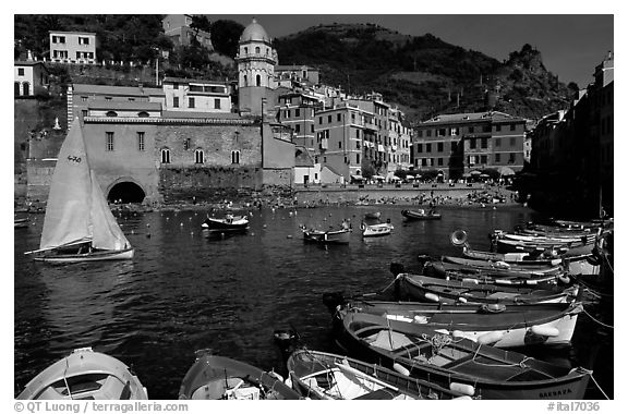 Colorful fishing boats in the harbor and Piazza Guglielmo Marconi, Vernazza. Cinque Terre, Liguria, Italy