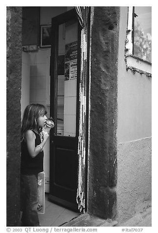 Girl enjoying gelato (ice-cream), Vernazza. Cinque Terre, Liguria, Italy (black and white)