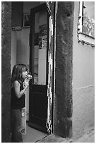 Girl enjoying gelato (ice-cream), Vernazza. Cinque Terre, Liguria, Italy ( black and white)