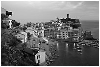 Harbor, church, medieval castle and village, sunset, Vernazza. Cinque Terre, Liguria, Italy (black and white)