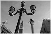Lamps, Campanile, column with Lion, Piazza San Marco (Square Saint Mark), early morning. Venice, Veneto, Italy ( black and white)