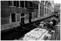 Delivery through a little canal. Venice, Veneto, Italy (black and white)