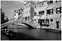 Bridge spanning a canal, Castello. Venice, Veneto, Italy (black and white)
