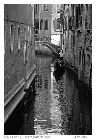 Gondola and reflections in a narrow canal. Venice, Veneto, Italy (black and white)