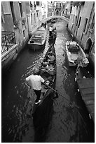 Gondolas lined up in narrow canal. Venice, Veneto, Italy ( black and white)
