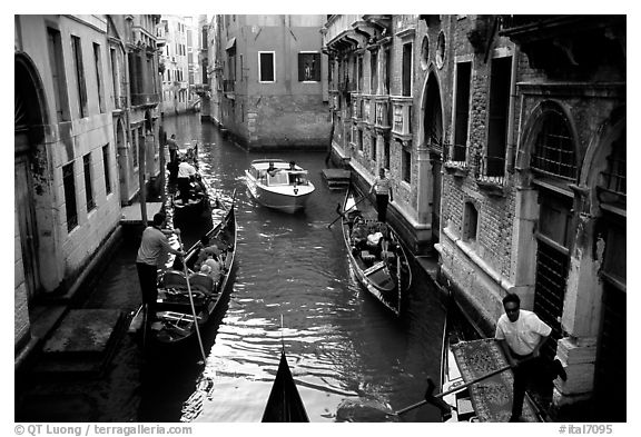 Busy water trafic in  narrow canal. Venice, Veneto, Italy (black and white)