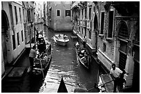 Busy water trafic in  narrow canal. Venice, Veneto, Italy ( black and white)