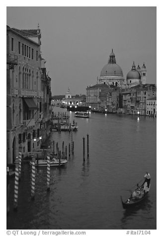 Gondola, Grand Canal, Santa Maria della Salute church from the Academy Bridge, dusk. Venice, Veneto, Italy (black and white)