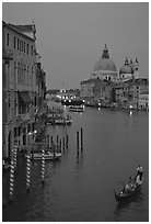 Gondola, Grand Canal, Santa Maria della Salute church from the Academy Bridge, dusk. Venice, Veneto, Italy ( black and white)