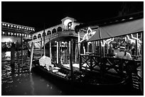Gondolier and gondola, Rialto Bridge at night. Venice, Veneto, Italy ( black and white)