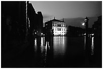 Grand Canal at night with lighted palace. Venice, Veneto, Italy (black and white)