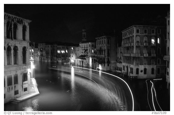 Light trails on the Grand Canal at night near the Rialto Bridge. Venice, Veneto, Italy