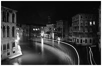 Light trails on the Grand Canal at night near the Rialto Bridge. Venice, Veneto, Italy ( black and white)