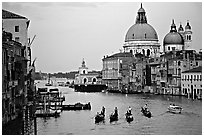 Gondolas, Grand Canal, Santa Maria della Salute church from the Academy Bridge, dusk. Venice, Veneto, Italy (black and white)