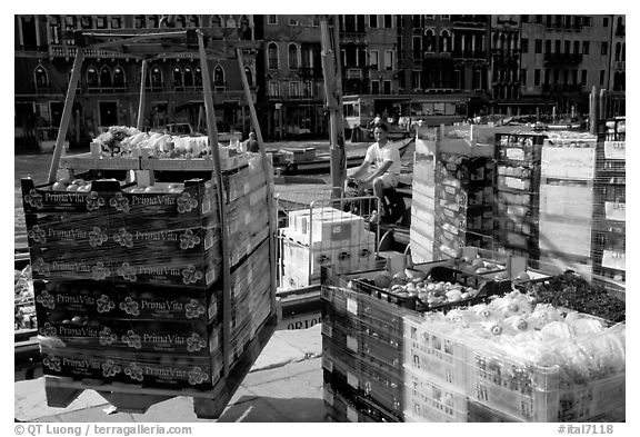Delivery of fresh produce from the Grand Canal. Venice, Veneto, Italy (black and white)