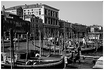 Parked gondolas on the the Grand Canal. Venice, Veneto, Italy (black and white)