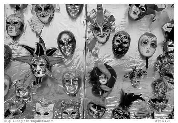 Carnival masks over golden background, Burano. Venice, Veneto, Italy (black and white)