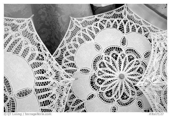 Lace, the specialty of the island of Burano. Venice, Veneto, Italy (black and white)