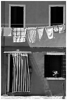 Hanging laundry and colored wall, Burano. Venice, Veneto, Italy (black and white)
