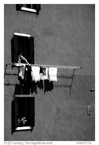 Windows, hanging laundry, blue house, Burano. Venice, Veneto, Italy (black and white)