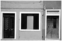 Doors, window, multicolored houses, Burano. Venice, Veneto, Italy (black and white)