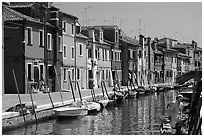 Canal lined with typical brightly painted houses, Burano. Venice, Veneto, Italy ( black and white)