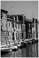 Canal lined with brightly painted houses, Burano. Venice, Veneto, Italy (black and white)