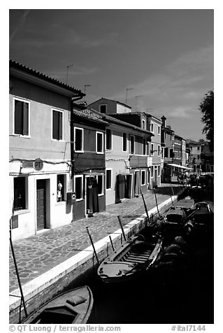 Canal lined with houses painted with bright colors, Burano. Venice, Veneto, Italy (black and white)