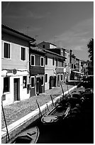 Canal lined with houses painted with bright colors, Burano. Venice, Veneto, Italy ( black and white)