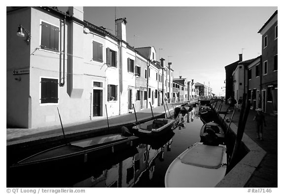 Colorful painted houses along canal, Burano. Venice, Veneto, Italy (black and white)