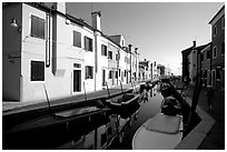 Colorful painted houses along canal, Burano. Venice, Veneto, Italy ( black and white)