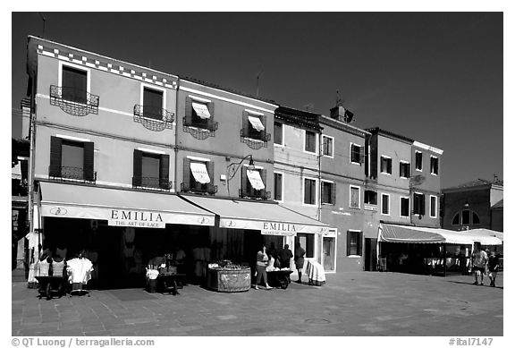 Street with brightly painted houses, Burano. Venice, Veneto, Italy (black and white)
