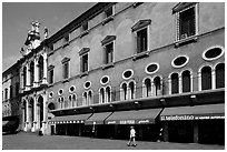 Store in renaissance building, Piazza dei Signori. Veneto, Italy ( black and white)