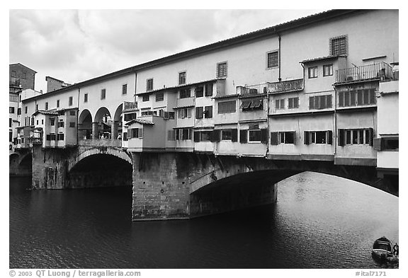 Ponte Vecchio (1345),  old bridge lined with shops. Florence, Tuscany, Italy (black and white)