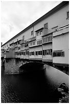 Ponte Vecchio bridge covered with shops, spanning  Arno River. Florence, Tuscany, Italy ( black and white)