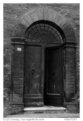 Old door. Siena, Tuscany, Italy (black and white)
