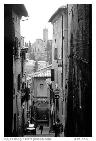 Narrow street with church in background. Siena, Tuscany, Italy (black and white)
