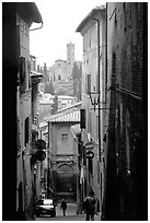 Narrow street with church in background. Siena, Tuscany, Italy ( black and white)
