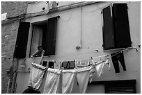 Woman hanging laundry. Siena, Tuscany, Italy ( black and white)