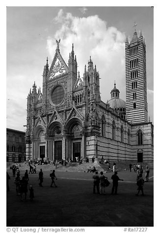 Richly decorated cathedral facade, afternoon. Siena, Tuscany, Italy